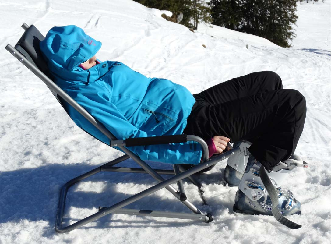 Relaxing on a sunbed on the snow